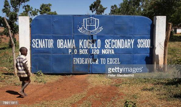 A boy passes the gates of a school named after US Senator Barack Obama on January 12 2007 in Kogelo western Kenya Barack Hussein Obama father of US...