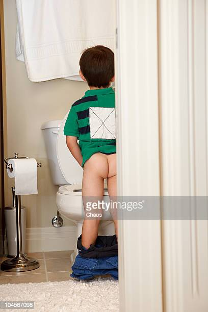 Boy peeing in the toilet