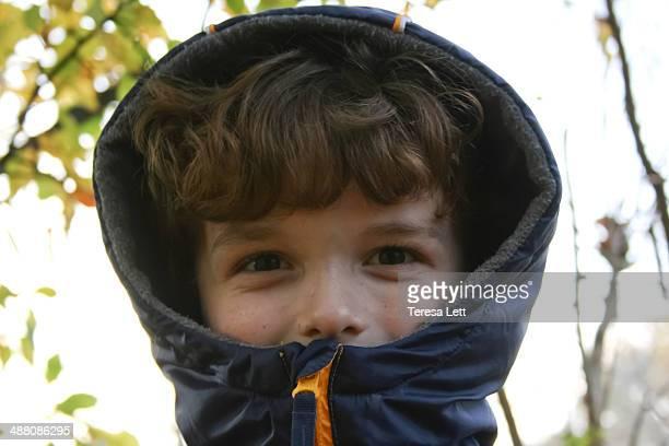 Boy peeking out of hood