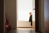 Boy peeking round doorway