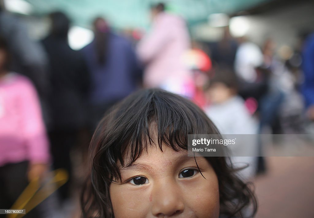 A boy peers into the camera at a clothing fair put on by the Virgin of the Miracles of Caacupe church in the Villa 21-24 slum, where archbishop Jorge Mario Bergoglio, now Pope Francis, used to perform charity work, on March 15, 2013 in Buenos Aires, Argentina. The fair offers affordable clothing to local residents. Francis was the archbishop of Buenos Aires and is the first pope to hail from South America. Some locals are now affectionately calling Francis, known for his charity work in the slums, the 'slum pope.'