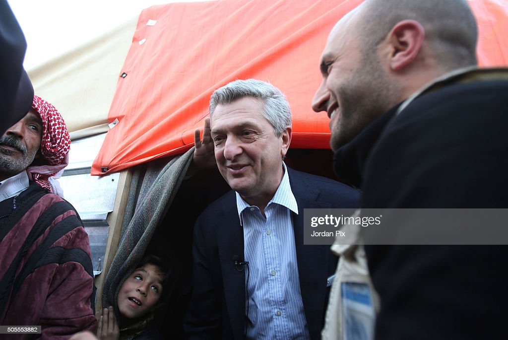 A boy peers up at Filippo Granti the new UNHCR High Commissioner as he visits the Zaatari camp for Syrian refugees on January 18 2016 in Zaatari...