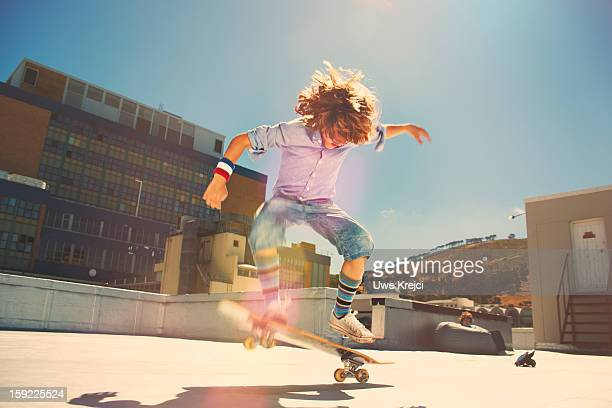Boy performing jump on skateboard