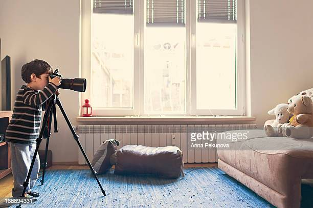 Boy photographing teddy-bears