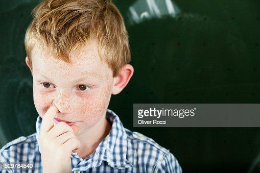 Boy picking nose : Stock Photo