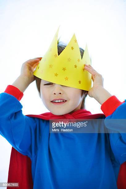Boy placing crown on head