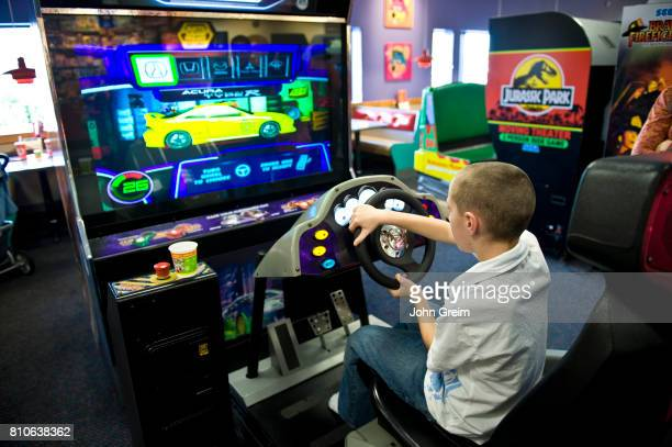 Boy playing an arcade video game