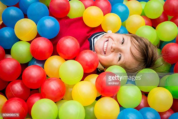 Boy playing at a ball pool