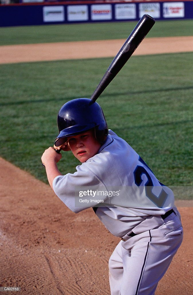 Boy (10-12) playing baseball : Stock Photo