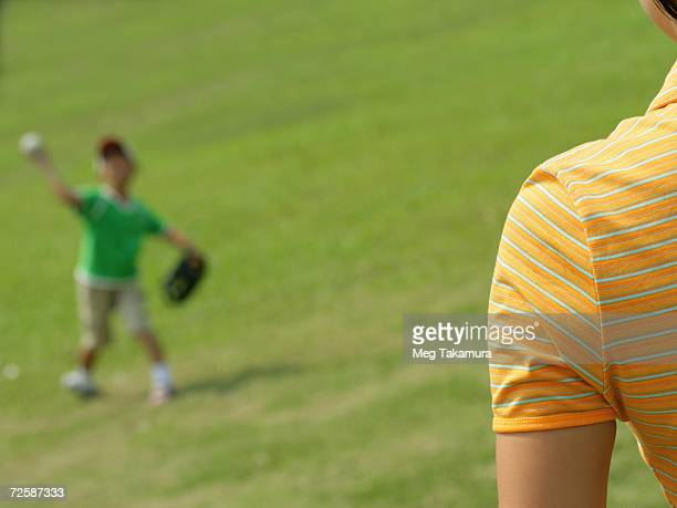 Boy playing catch with his mother