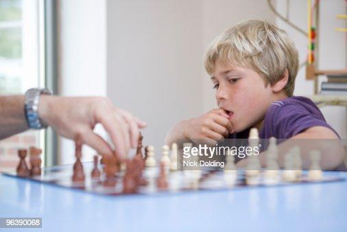 Boy playing chess : Stock Photo