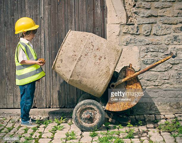 Boy playing construction with mixer