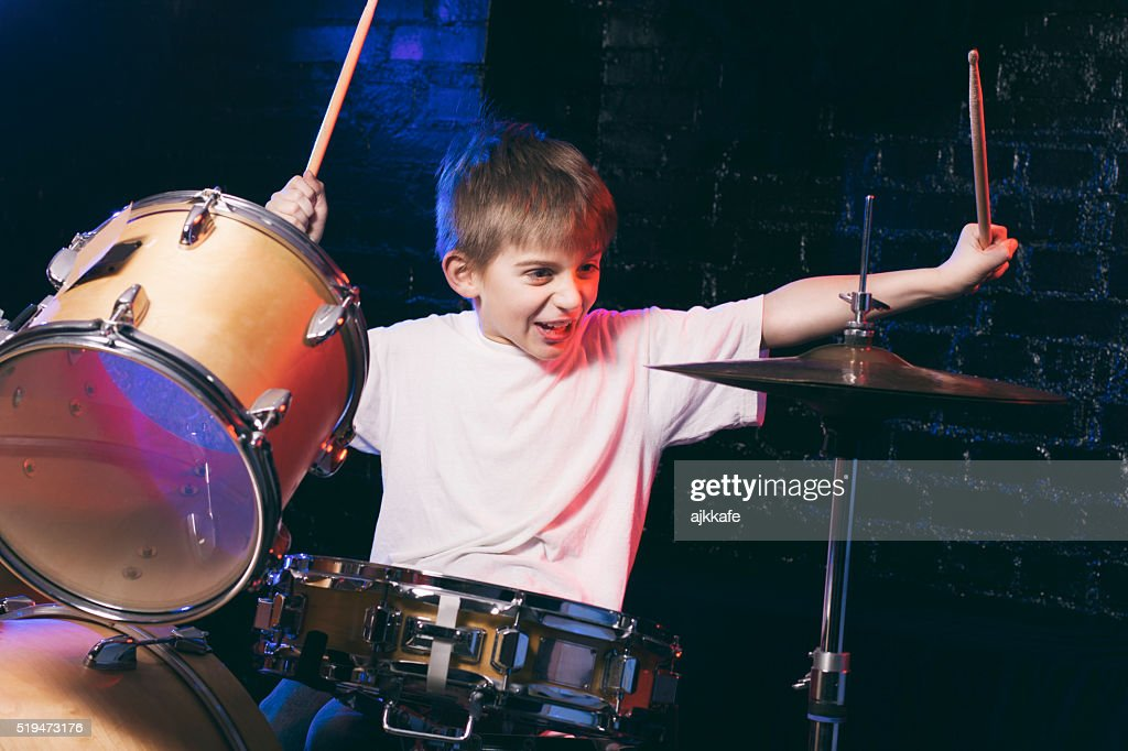 Boy playing drums : Stock Photo