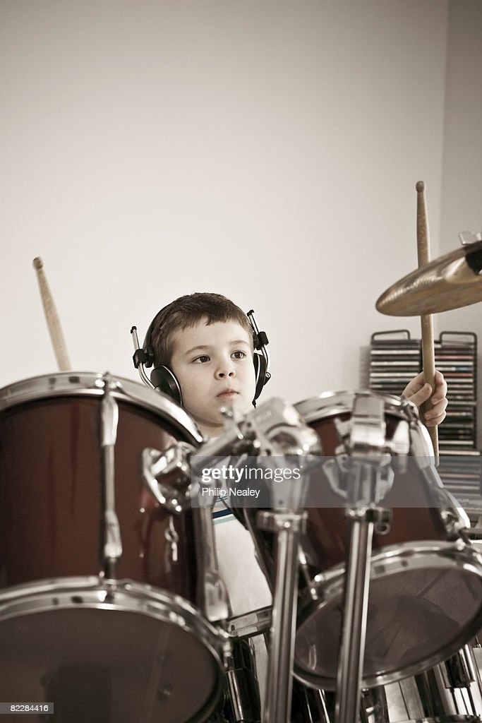Boy playing drums with band : Stock Photo