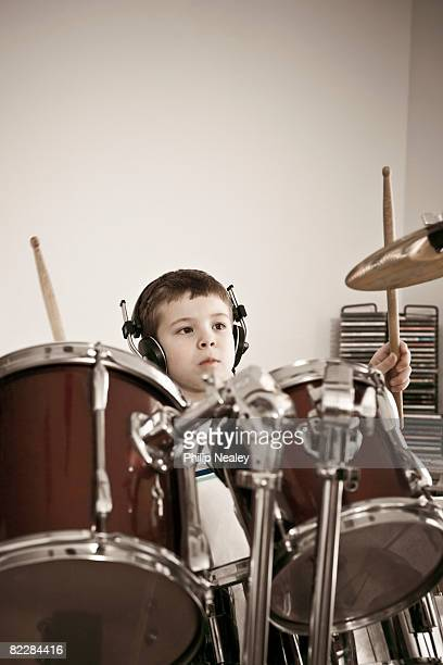 Boy playing drums with band