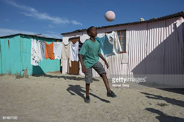 Boy playing football in South Africa