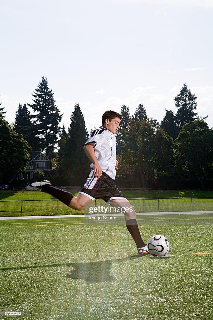 Boy playing football : Stock Photo