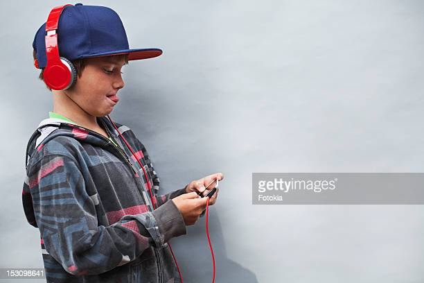 Boy playing game on portable media player