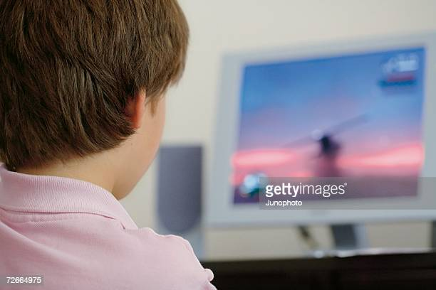 Boy playing games on desktop computer