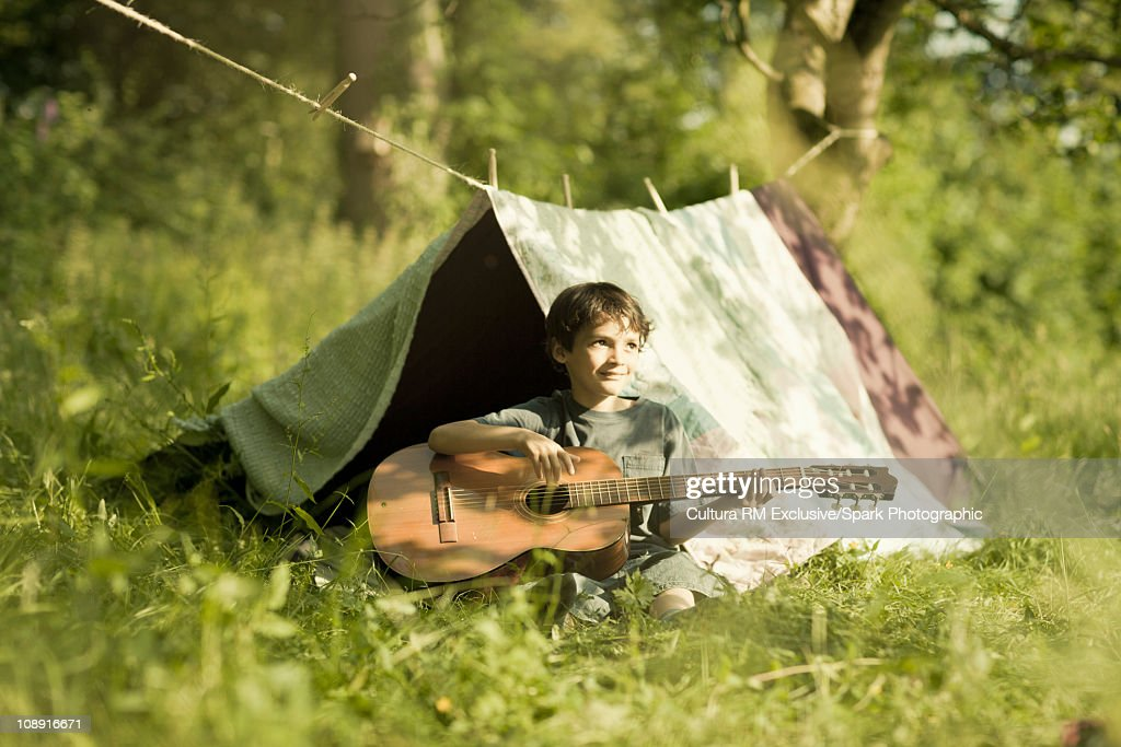 Boy playing guitar : Stock Photo