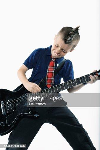 Boy (8-10) playing guitar : Stock Photo