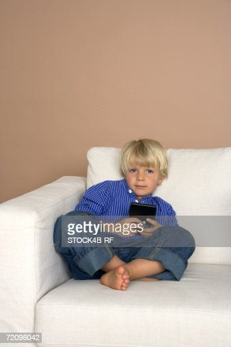 Boy (4-5 Years) playing hand held computer game