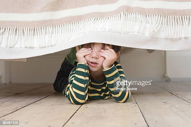 Boy playing hide and seek