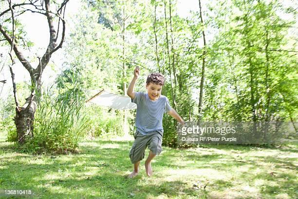 Boy playing in backyard