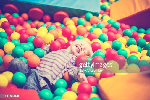 Boy playing in ball pit : Stock Photo