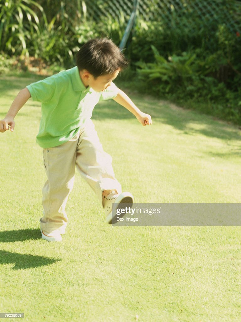 Boy playing in garden : Stock Photo