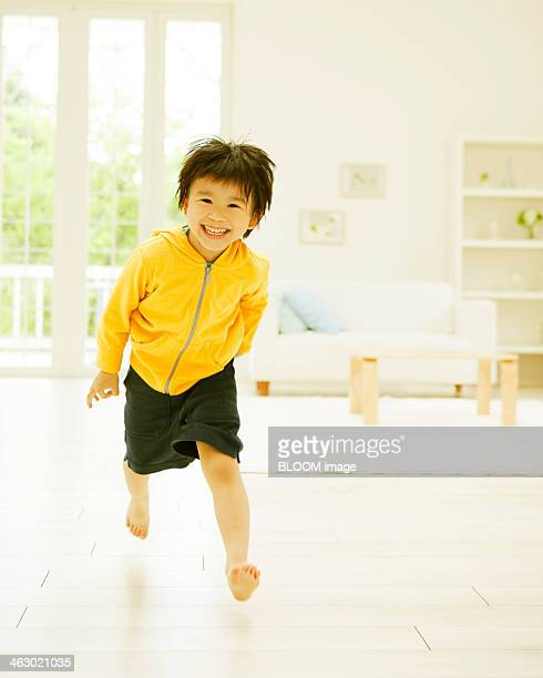 Boy Playing In Living Room