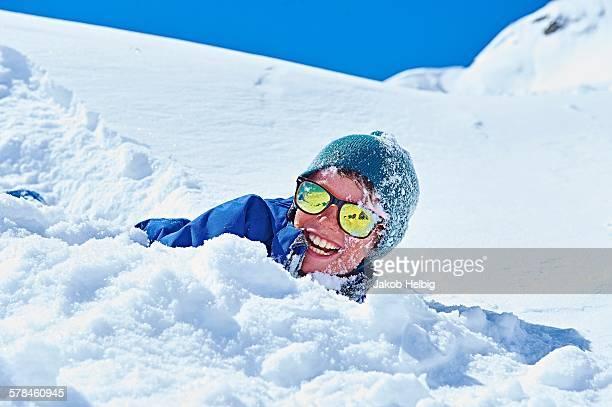 Boy playing in snow, Chamonix, France