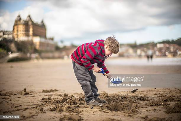 A boy playing in the sand