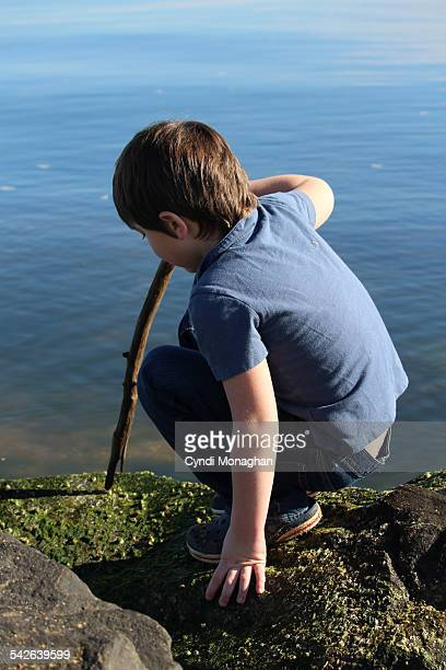 Boy playing next to water