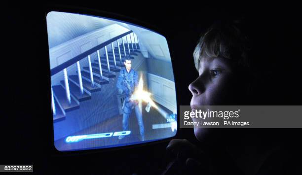 A boy playing on a Play Station computer game