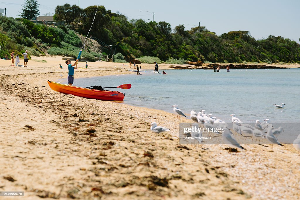 Boy playing on beach : Stock Photo