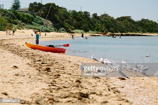 Boy playing on beach : Stock Photo