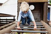 Boy playing on monkey bars