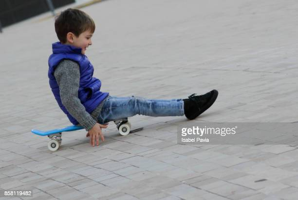 Boy playing on skateboard