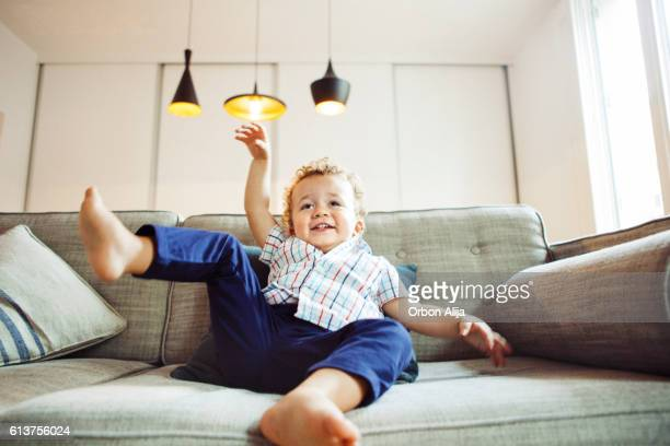Boy playing on the sofa