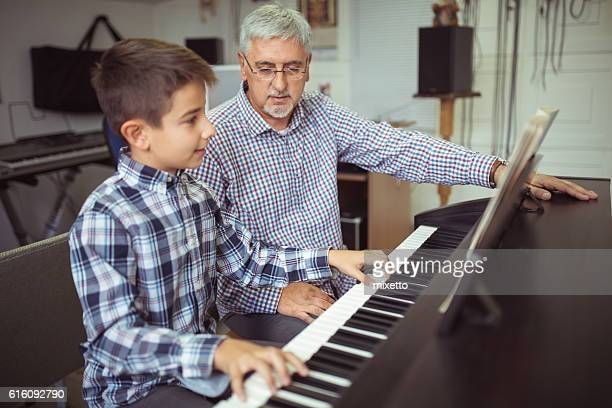 Boy playing piano on the class music
