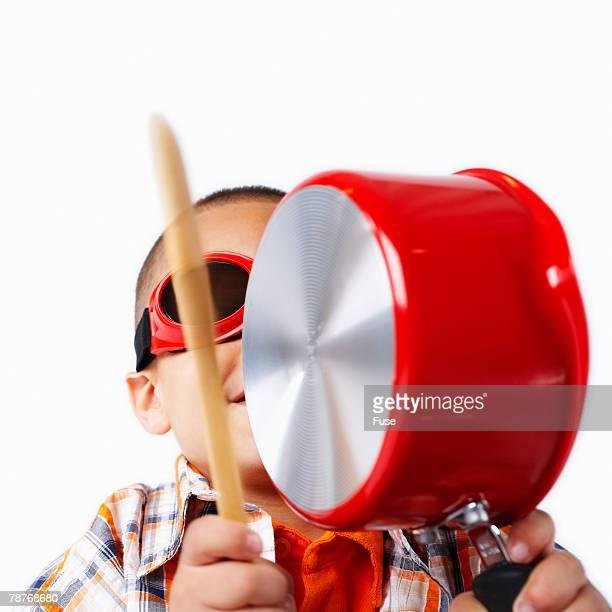 Boy Playing Saucepan