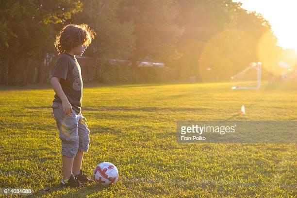 Boy playing soccer.