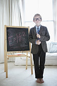Boy playing teacher in living room