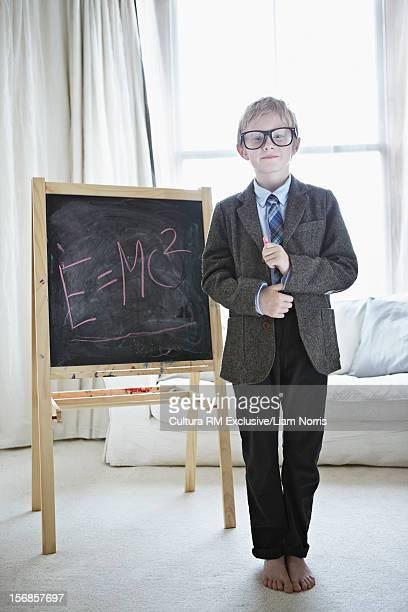 Boy playing teacher in living room