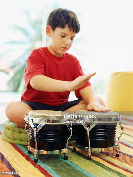 Boy playing the bongo drums