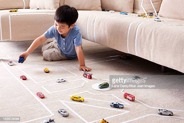 Boy playing toy car at home