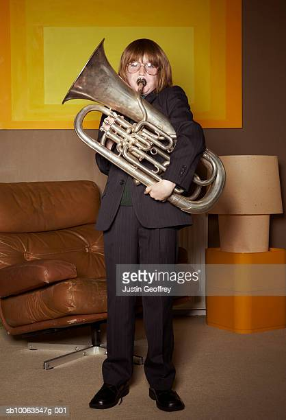 Boy (8-10) playing trombone