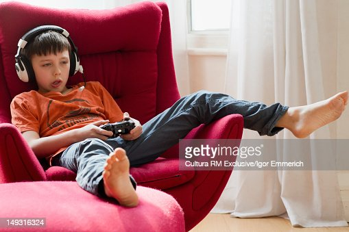 Boy playing video games with headphones