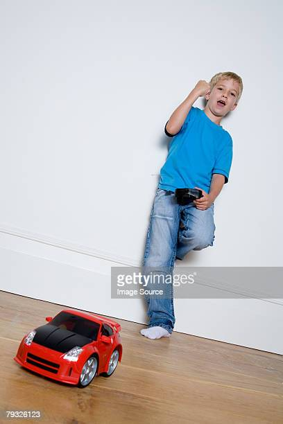 Boy playing with a remote controlled car